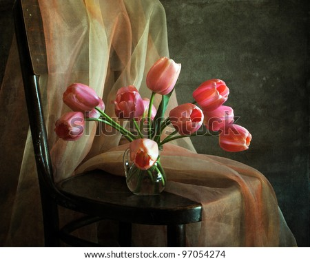 Still life with a bouquet of tulips - stock photo