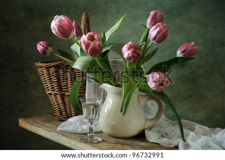 Still life with a bunch of tulips - stock photo