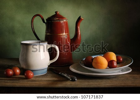 Still life with a coffee pot and apricots - stock photo