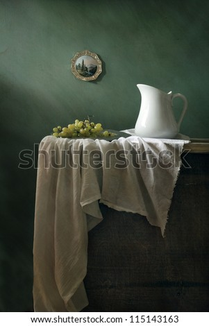 Still life with a copper-plate engraving - stock photo