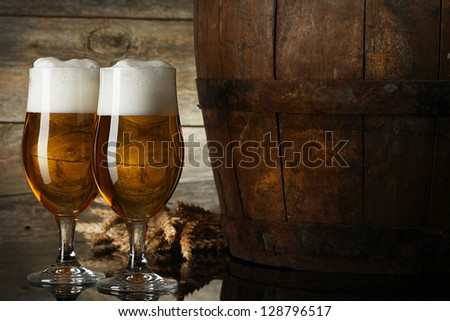 Still Life with a keg of beer and beer in the glass - stock photo