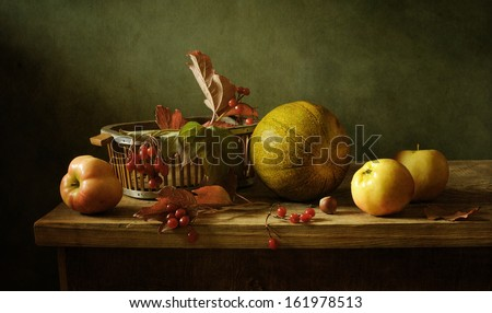 Still life with a melon and apples - stock photo