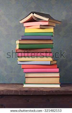 Still life with a pile of books, a vertical shot. Back to school. - stock photo