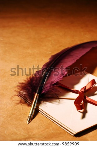 Still-life with a quill and a letters on a background of a rough paper surface - stock photo