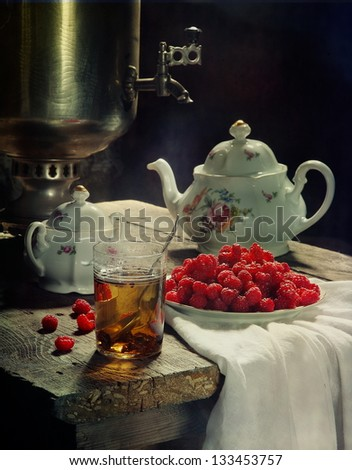 Still-life with a raspberry, a tasty breakfast with fragrant tea and a tasty sweet fresh berry a raspberry - stock photo