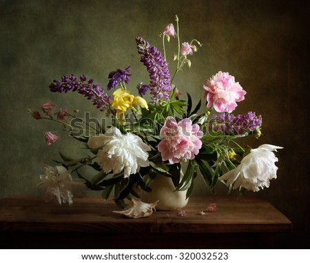 Still life with a voluptuous bunch of flowers (textured for artistic effect) - stock photo