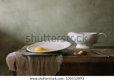 Still life with a white gravy boat - stock photo