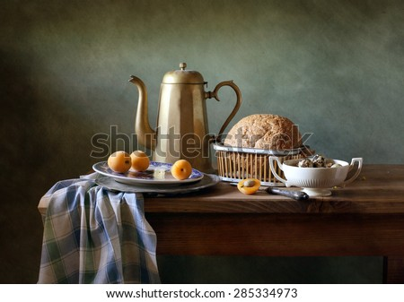 Still life with an antique coffee pot - stock photo