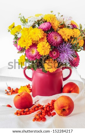 Still life with autumnal flowers and fruits - stock photo