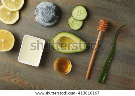 Still life with avocado oil on wooden background - stock photo