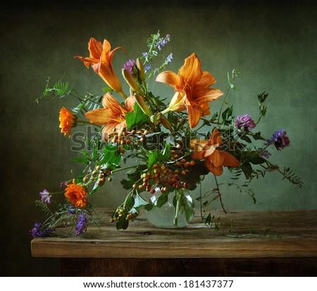 Still life with beautiful orange lilies - stock photo