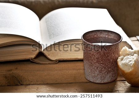 still life with Bible chalice and bread - stock photo