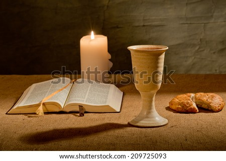 still life with bible chalice wine of  and bread - stock photo