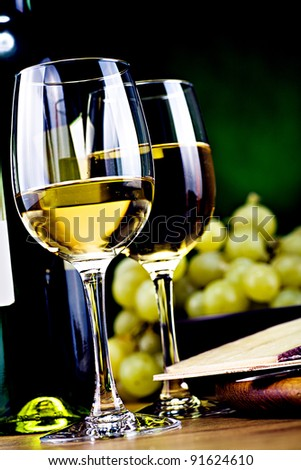 still life with bottle of white wine and cheese - stock photo