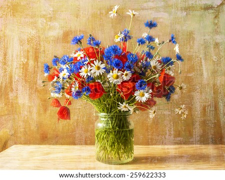 Still life with bouquet of colorful wild flowers - stock photo
