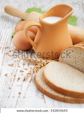 still life with bread, milk and eggs - stock photo