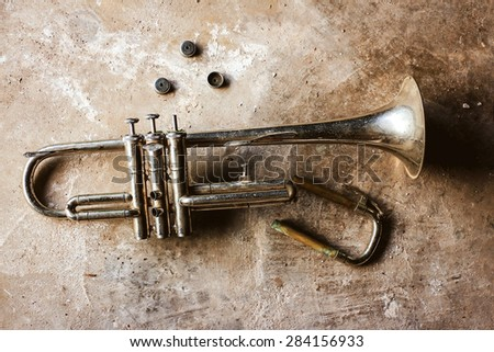 Still life with broken trumpet  - stock photo