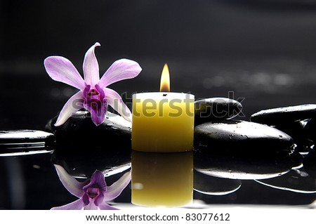 Still life with burning spa candle with pink orchid and stones - stock photo