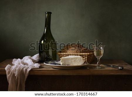 Still life with cheese and a glass of wine - stock photo