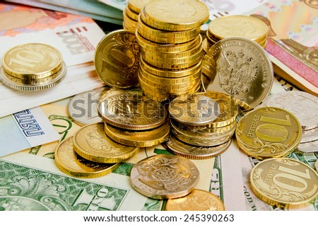 Still life with coins and banknotes of different countries. - stock photo