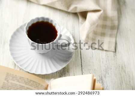 Still life with cup of coffee and book, close up - stock photo