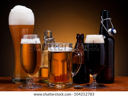 still life with different types of beer in glass and bottle - stock photo