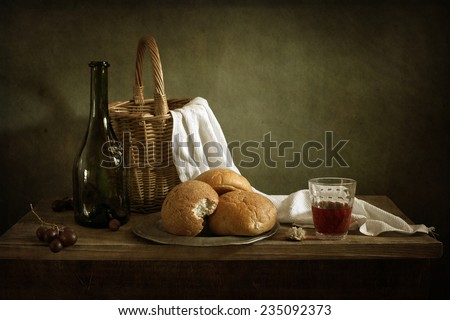 Still life with fresh bread and red wine - stock photo