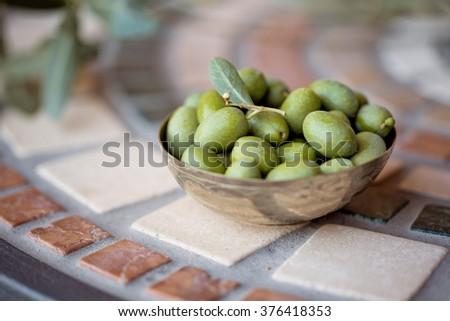 Still Life with Fresh green Olives harvested from Tree on Italian Farm - stock photo