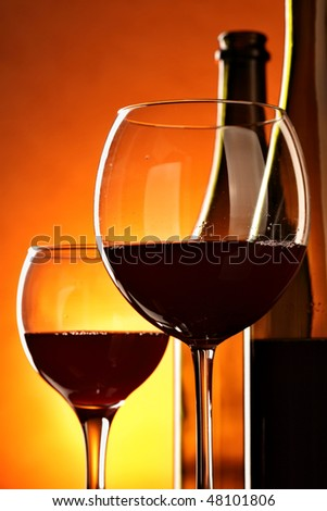 Still-life with glass and bottle of red wine - stock photo