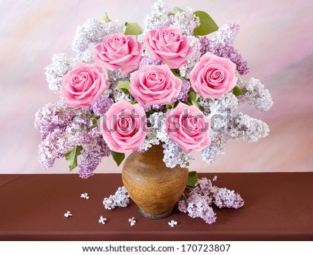 Still life with huge bunch of roses, lilac flowers  on painting background - stock photo