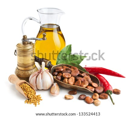 Still life with ingredients for preparing beans isolated on white - stock photo