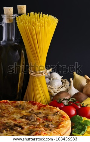 still life with italian pizza, pasta and ingredients - stock photo