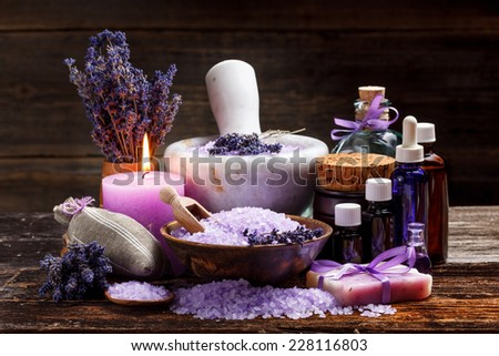 Still life with lavender candle, soap, salt and dried lavender - stock photo