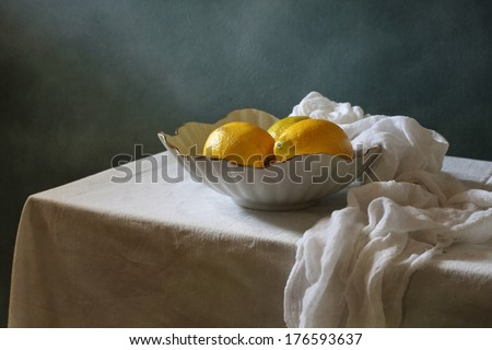 Still life with lemons and drapery - stock photo