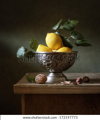 Still life with lemons in a bowl - stock photo