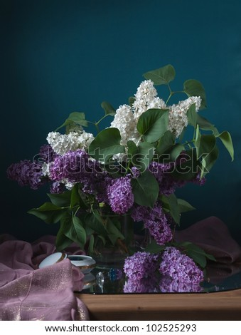 still life with lilac flowers - stock photo