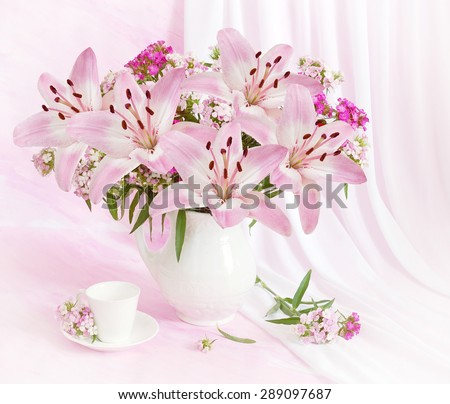 Still life with lily flowers on artistic background - stock photo