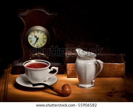 Still life with old books, and pipe and tea - stock photo