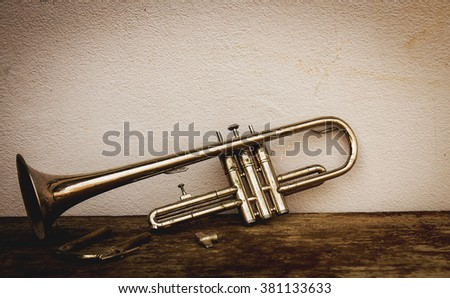 Still life with old trumpet. dark tone image style. - stock photo