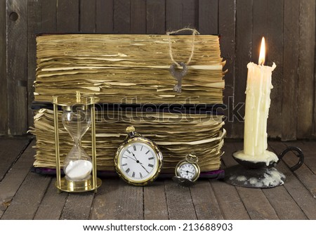 Still life with old watches and books on wooden background - stock photo