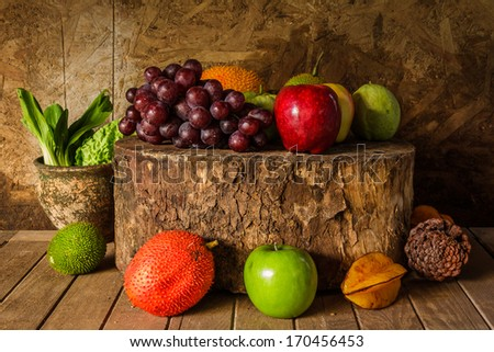 Still life with on the timber full of fruit in the kitchen. - stock photo
