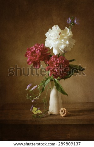 Still life with peonies (textured for retro effect) - stock photo