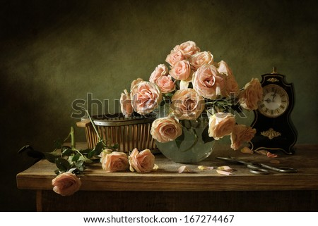 Still life with pink roses and an ancient clock - stock photo