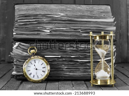 Still life with pocket watch and sand clock on wooden background, black and white style - stock photo