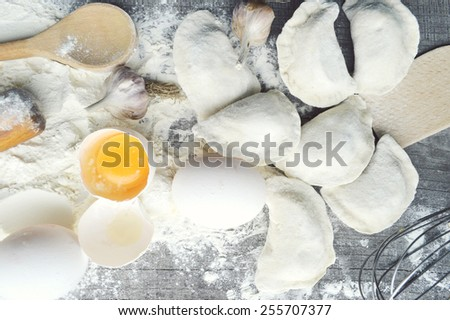 still life with raw homemade pasta and ingredients for pasta..process of cooking pasta.the process of making homemade dumplings,delicious lunch - stock photo