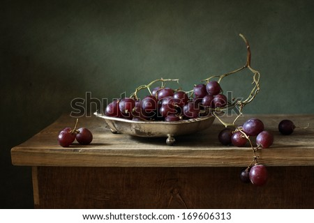 Still life with red grapes - stock photo