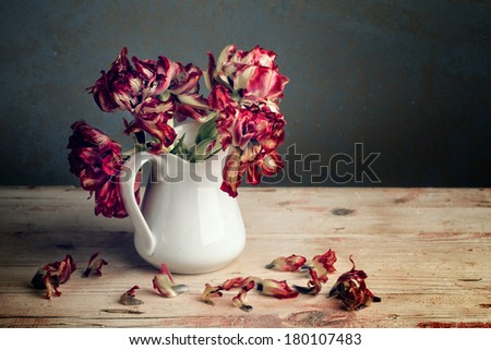 Still Life with Red Tulip Flowers in Porcelain Can - stock photo