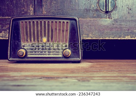 still life with retro radio on the floor in old house. - stock photo