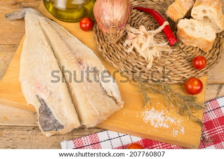 Still life with salt cured cod fish and Mediterranean ingredients - stock photo