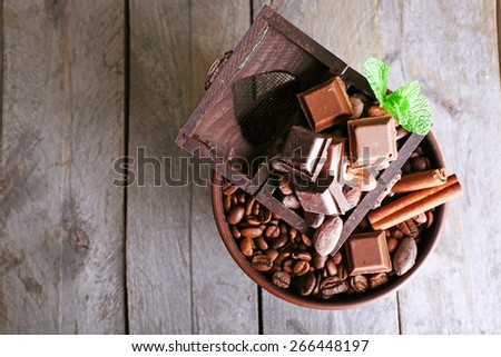 Still life with set of chocolate  and coffee beans on wooden background - stock photo